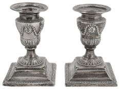 A pair of late Victorian silver neo-classical design Adam style dwarf candlesticks