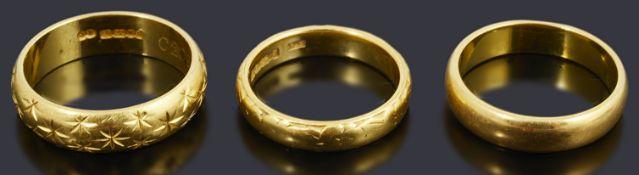 Three 22ct gold wedding bands