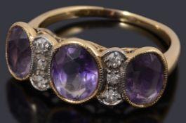An unusual gold amethyst and diamond three stone ring