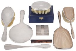 A mixed lot of silver to include dressing table sets, a compact and a boxed clothes brush and comb