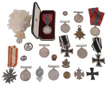 A selection of WWI and WWII medals and other related items