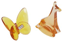 Two Baccarat orange crystal paperweights