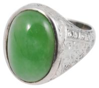 A white gold single stone jade cabochon and diamond ring