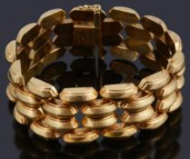 A four row hollow raised lozenge shaped panel bracelet