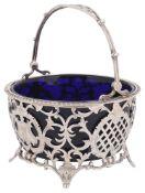 An Edward VII silver swing handled sugar basket