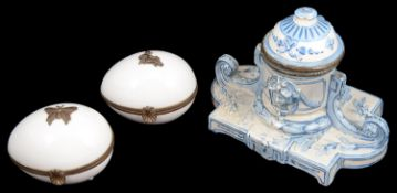 A 19th century continental faience inkwell and two Limoges egg shaped porcelain trinket boxes