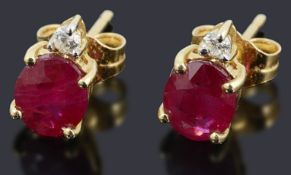 A pair of ruby and diamond stud earring,