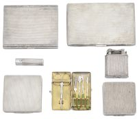 A collection of mid 20th century engine turned silver items to include