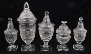 A collection of five 19th century and later Regency style sweetmeat jars and covers