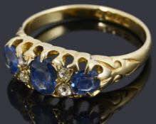 An early Edwardian 18ct gold sapphire and diamond three stone ring