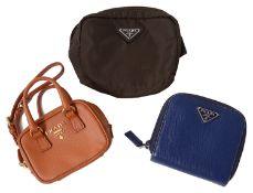 Three Prada coin purses