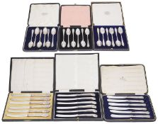 Six early 20th century cased sets of six silver coffee spoons and silver handled tea knives