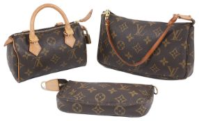Three Louis Vuitton pouches in the classic monogrammed canvas