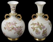 A matched pair of Royal Worcester blush Ivory twin handled vases, circa late 19th Century