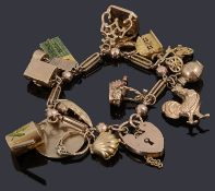 A gold charm bracelet with padlock and various gold charms