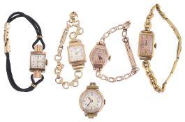 An assortment of gold watch heads on bracelets