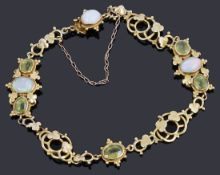 A delicate Victorian gold opal and peridot bracelet,