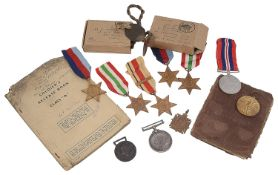 A collection of WWI and WWII medal groups and related items