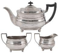 A George V silver three piece tea service