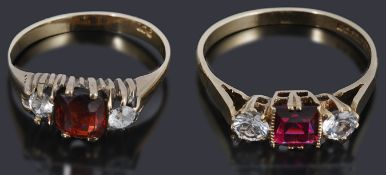 Two 9ct gold three stone rings