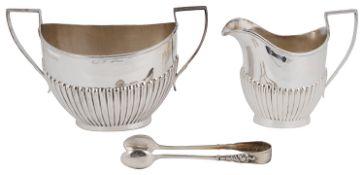 An Edwardian silver twin handled sugar bowl and milk jug