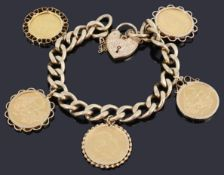A 9ct gold hollow curb link chain with paddock and four assorted sovereigns and a half sovereign,
