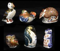 A collection of Royal and Crown Derby animal paperweights