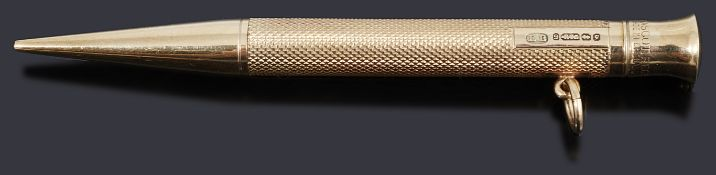 A 9ct gold propelling pencil, with engine turned decoration and a plain polished nib