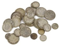 A small selection of post 1920 half crowns and other coins