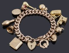 A 9ct gold hollow curb link bracelet with padlock and twelve assorted charms