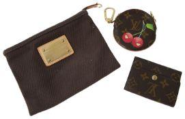 Louis Vuitton canvas pouch, a Louis Vuitton circular cherry coin purse and a Louis Vuitton wallet