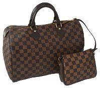 A Louis Vuitton Damier Ebene canvas speedy 35 handbag,