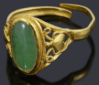 A high carat gold single stone green cabochon ring,