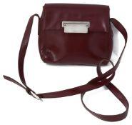A vintage Prada red leather handbag