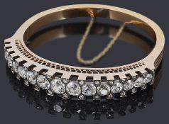 An attractive late 19th Century Swiss 18ct gold diamond hinge bangle