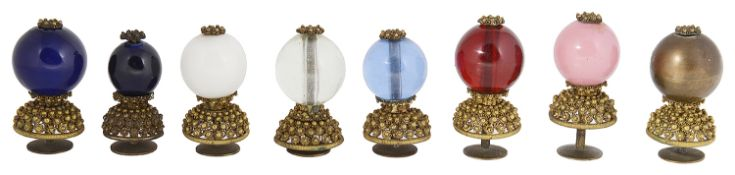A collection of eight 19th century Qing dynasty Mandarin gilt metal and Peking glass hat buttons