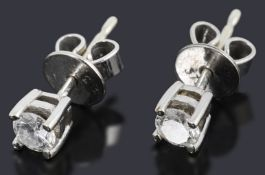 A pair of 9ct white gold diamond stud earrings