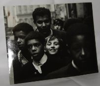 Black and white photograph of children in Liverpool by Astrid Kirchherr signed on reverse. size