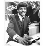 Two early promotional photographs of Apple recording artist Billy Preston