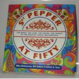 Sgt. Pepper At Fifty signed by author Mike McInnerney and Dudley Edwards who painted Paul
