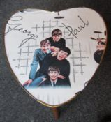 Heart form Beatles Table with Beatles wallpaper under glass. Approx.16 inch high,14 inch width,1964