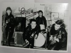 Black and white 12 x 8 photograph of The Beatles in Cavern Club signed by Pete Best