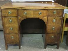 19th century inlaid mahogany serpentine fronted sideboard. Approx. 97cm H x 122cm W x 71.5cm D