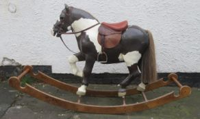 Vintage APES hand decorated child's rocking horse, mounted on wooden stand. Approx. 113cm H x