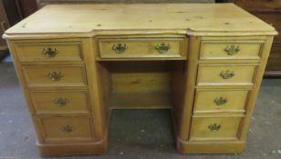Early 20th century stripped pine nine drawer kneehole writing desk. Approx. 73cm H x 115cm W x 49.