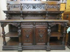 19th century heavily carved oak serving buffet/sideboard, fitted with two drawers, two cupboard