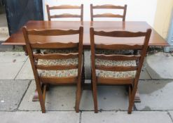 20th century carved oak refectory style dining table, with four ladderback chairs