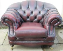20th century oxblood upholstered Thomas Lloyd button back chesterfield armchair. Approx. 86cm High