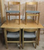 Mid 20th century teak extending dining table with one leaf and six chairs