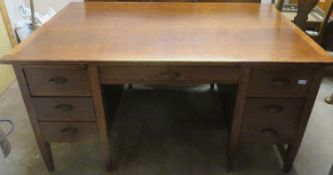 Mid 20th century oak office desk, fitted with seven drawers & two slides. Approx. 77cms H x 152cms W